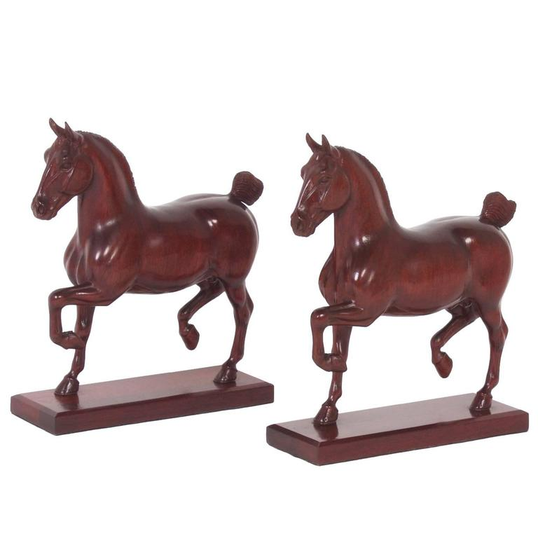 Two Peter Giba Horse Carvings