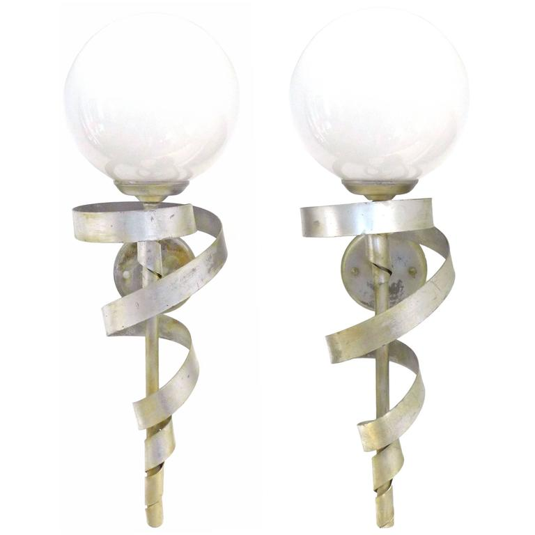 "Pair of Silver-Leaf ""Torch"" Sconces"