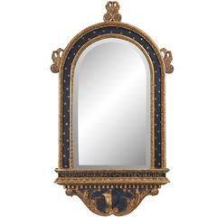 Italian Ebonized and a Parcel-Gilt Mirror