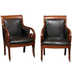 Pair of Empire Style Beechwood and Black Leather Bergeres with Scroll Arms
