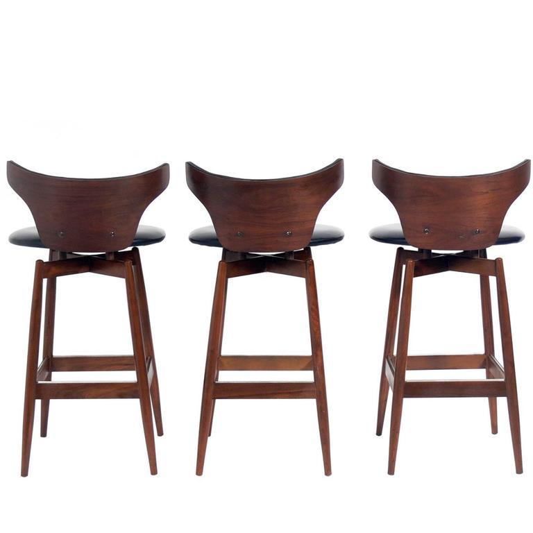 Set Of Three Curvaceous Walnut Modern Bar Stools At 1stdibs