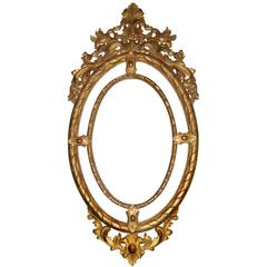 Large Oval Hand-Carved Giltwood Mirror