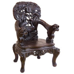 Exuberant Wood Armchair with Bird Motif and Floral Carving, Late 19th Century