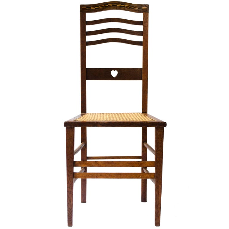 Shapland & Petter An Arts & Crafts Inlaid Oak Side Chair with a Pierced Heart For Sale