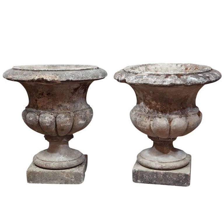 Pair of Carved Stone Urns