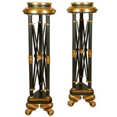 Pair of Hollywood Regency Black and Gilt Pedestals