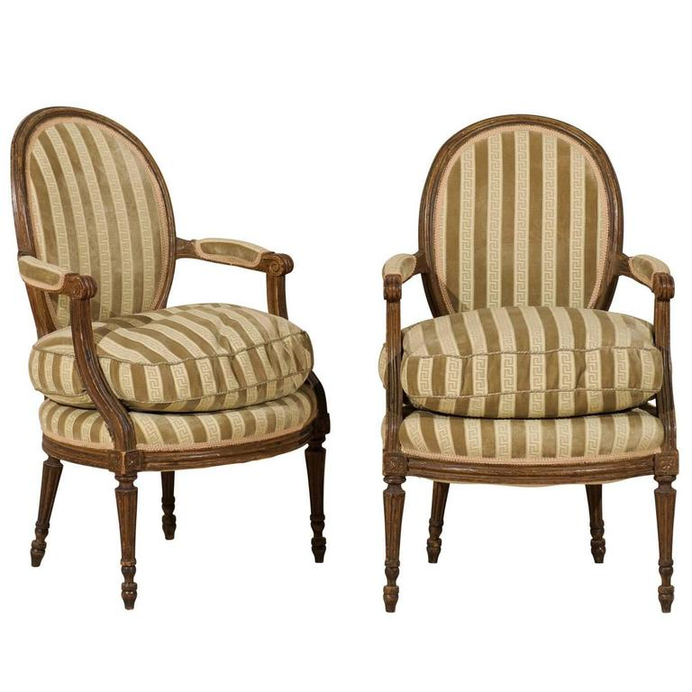 Pair of French 19th Century Louis XVI Style Bergères Oval Back Chairs 1