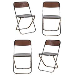 Set of Four Smoked Lucite Folding Chairs
