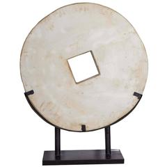 White Stone Coin Sculpture on Stand