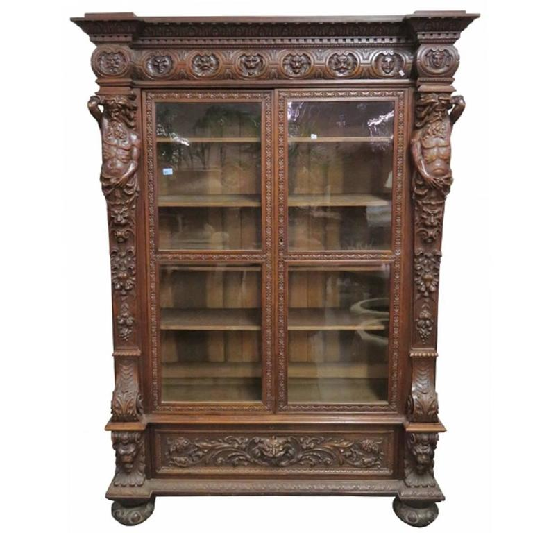 Antique Continental Figural Carved Bookcase For Sale At
