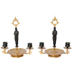 Pair of Patinated and Gilt Bronze Figural Candelabra