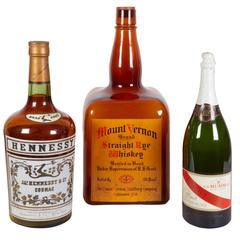 Set of Three Factice Cognac, Whiskey and Champagne Bottles