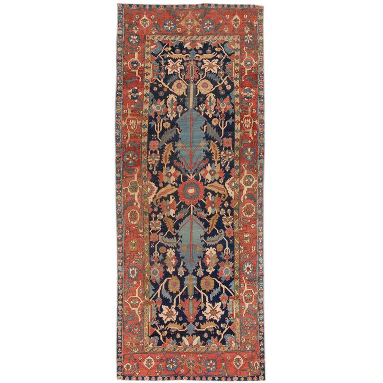 Early 20th Century. Antique Rust, Blue Persian Serapi Carpet