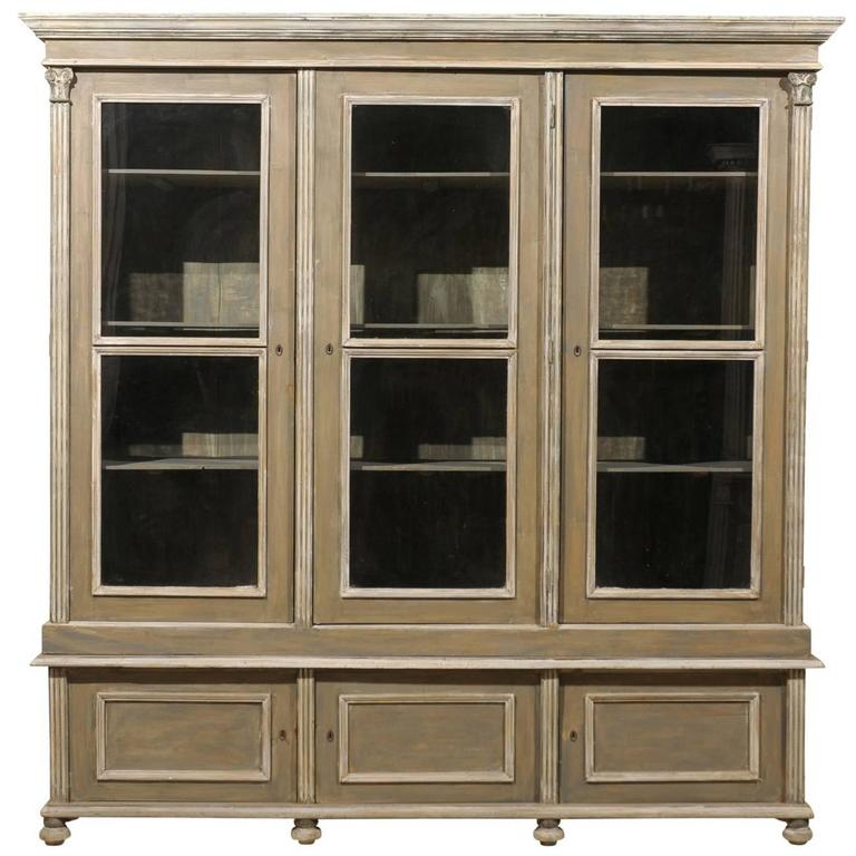 French 19th Century Wood Cabinet With Three Glass Doors Raised On