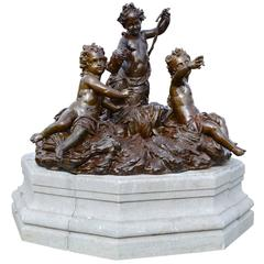 Important Cast Iron Group of Puttti Resting on a Granite Pedestal, 19th Century