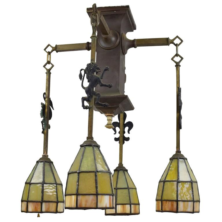 Gothic Arts and Crafts Chandelier with Emblems and Stained Glass Shades