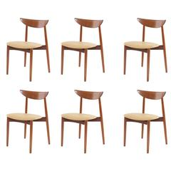 Six Harry Ostergaard Teak and Leather Dining Chairs