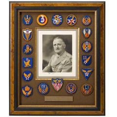 """Carl """"Tooey"""" Spaatz Signed War Photograph Surrounded by WW II Air Corps Patches"""