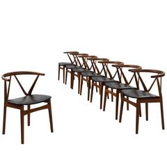 Henning Kjaernulf Set of Eight Dining Chairs in Teak and Black Upholstery