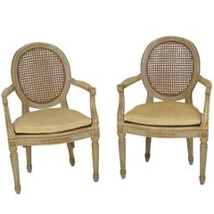 Pair of Antique Louis XVI Style Painted and Caned Fauteuils