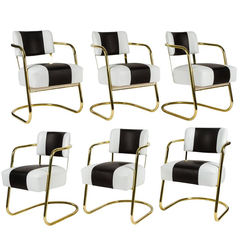 near set of six deco chairs in brass and leather for