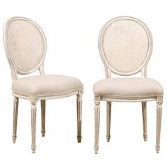 Pair of Louis XVI Style Oval Cane Back Chairs with Fluted Leg