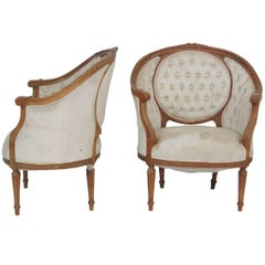 Pair of Round Back Louis XVI Style Carved Walnut Bergere Canape Chairs