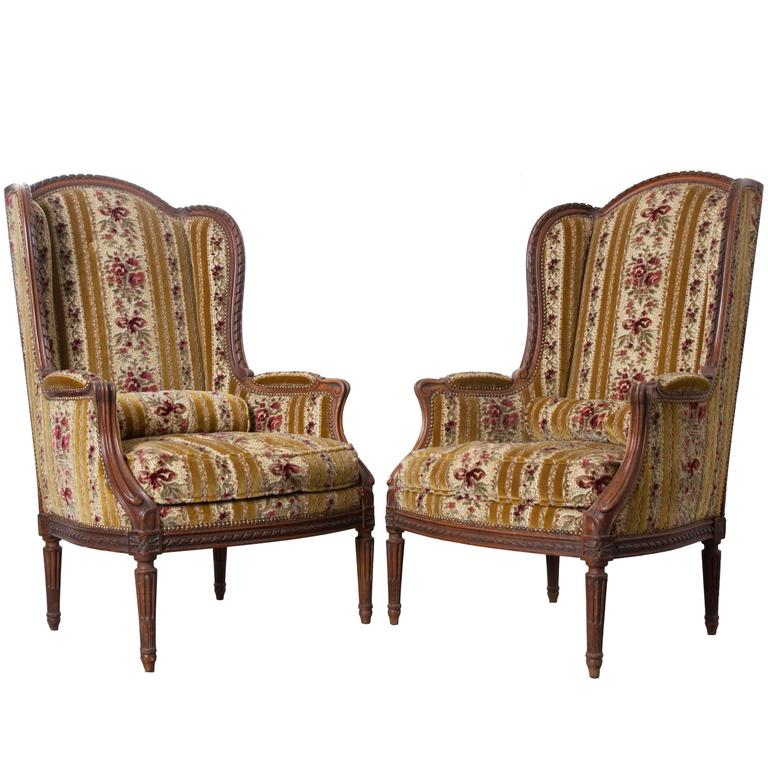 Pair of French 19th Century Walnut Transitional Wingback Bergères