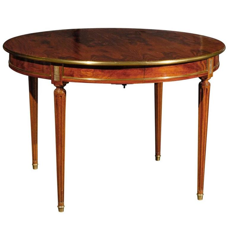 Th century round dining table with gilt bronze for sale