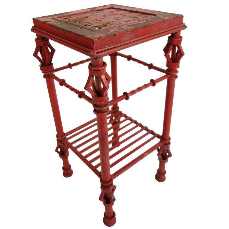 Red cast iron side table at 1stdibs for Cast iron end table