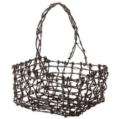 Fold Art Barbed Wire Hand Basket, circa 1930s