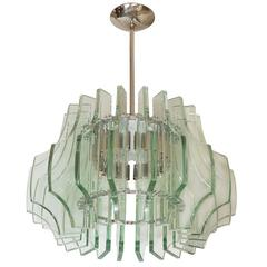 Circular Nickel Pendant Fixture with Multiple Carved Glass