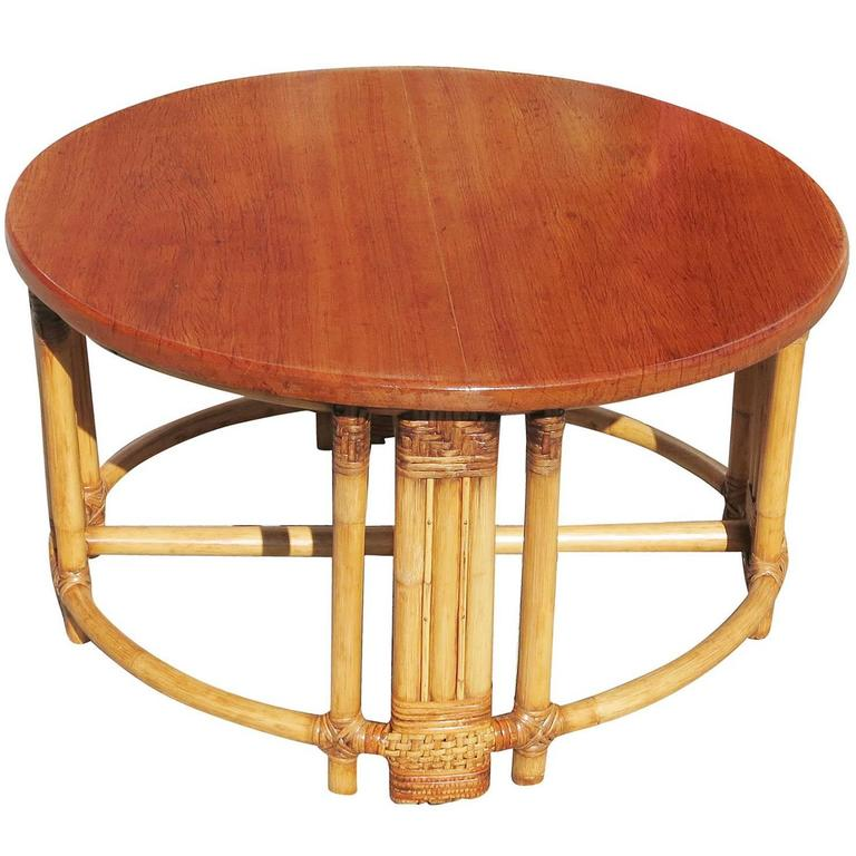 Round rattan coffee table with mahogany top and fancy wrapping for sale at 1stdibs Rattan round coffee table