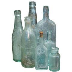Group of Seven Aqua Bottles