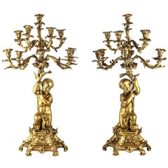 Pair of French Napollean IIi Gilt Bronze Figural Ten-Light Candelabras