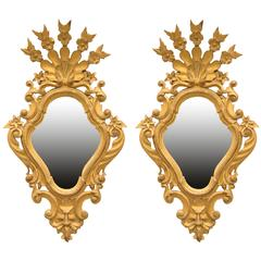Pair of sculptured wood and gilt mirror's made in 19th century