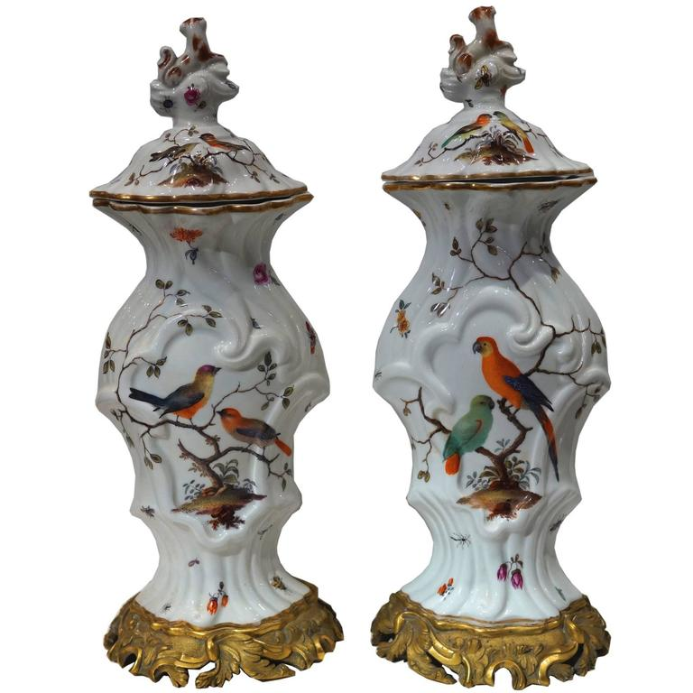 Pair of Aesthetic Painted Porcelain and Bronze Covered Urns with Bird and Flower For Sale
