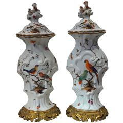 Pair of Aesthetic Painted Porcelain and Bronze Covered Urns with Bird and Flower