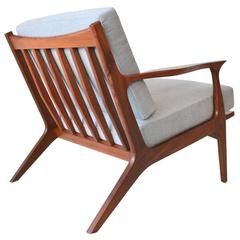 Sculpted Walnut Spindle Back Lounge Chair, circa 1960