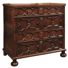 18th Century English Jacobean Style Oak Chest with Four Drawers and Bun Feet