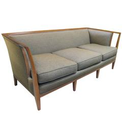 Shapely American T.H. Robsjohn-Gibbings Style Sofa with Flared Openwork Arms