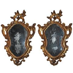 Pair of 18th Century Giltwood and Etched Looking Glass Venetian Mirrors