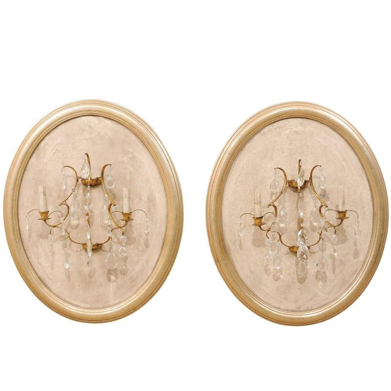 Pair of Neutral Cream Colored Crystal Sconces on Oval Wood Plaques, Two-Light