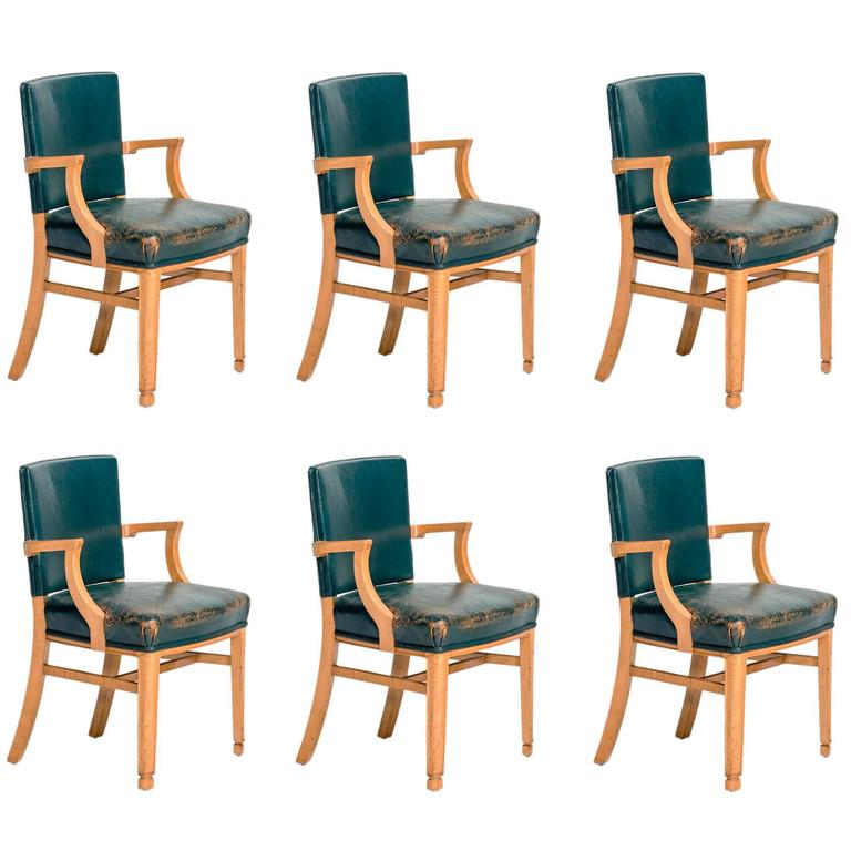 Set of six leather and maple wood dining chairs circa