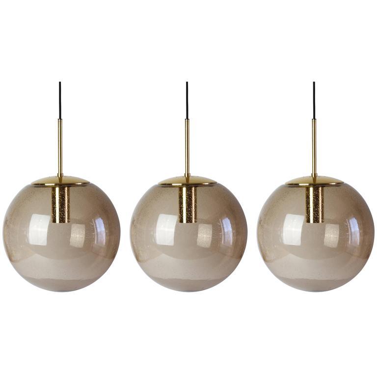 Twelve 1970s Spherical Smoked Glass Globe Pendant Lights by Glashütte Limburg