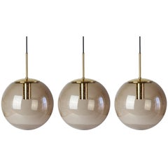 Twelve 1970s Spherical Smoked Glass Globe Pendant Lights by Glashütte Limburg