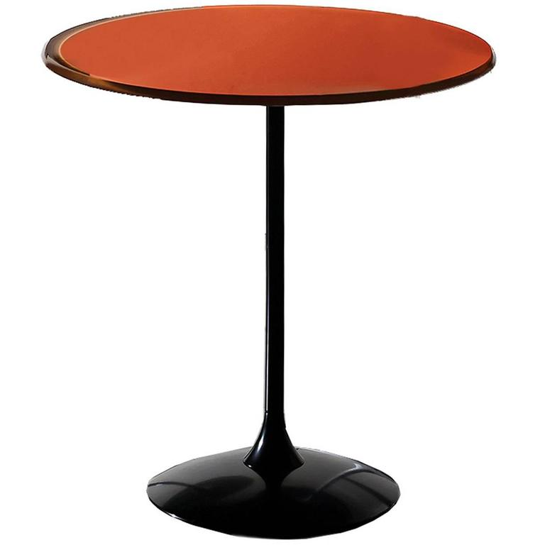 Round rust red coffee table with a contemporary design for for Red modern coffee table
