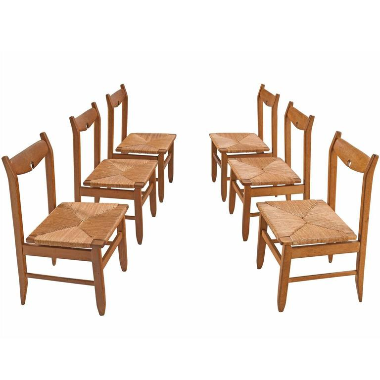 Guillerme & Chambron Set of Six Dining Chairs in Oak and Woven Seating