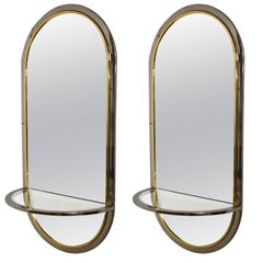 Pair of Oval Wall Mounted Mirror Consoles, USA, circa 1970
