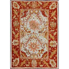 Antique Turkish Oushak with Elegant Motifs in Red, Ivory, Gold and Salmon Pink